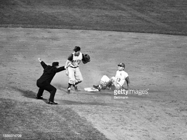 Looking for confirmation, Pirates' Bill Mazeroski can't believe the called safe on Carlie James' stretch double in the 4th inning in Cards-Pirates...