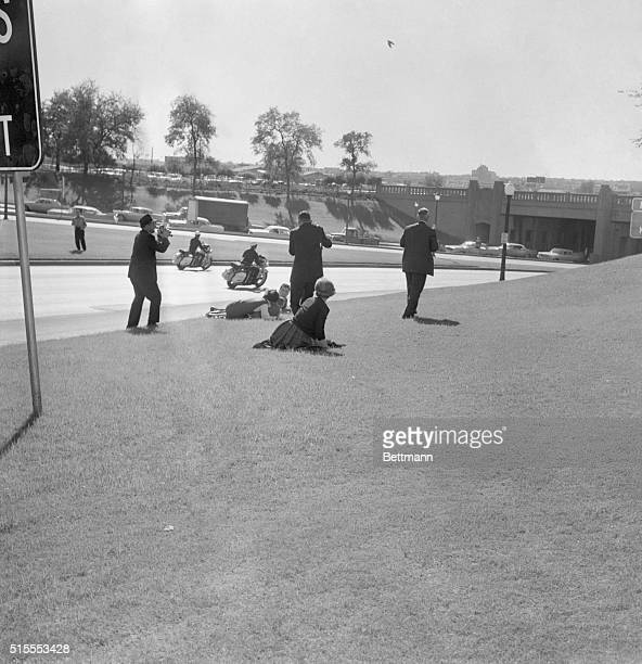 Looking For Cover Dallas A newsreel cameraman stands at the left as spectators hug the ground moments after a sniper's bullet ended President...
