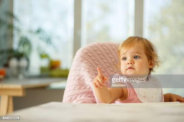 looking for food - baby pointing stock photos and pictures