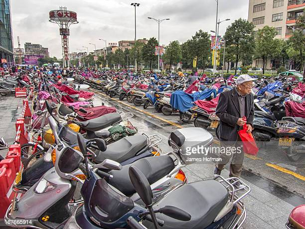 CONTENT] Looking for his motor scooter in a parking lot in Yangjiang China