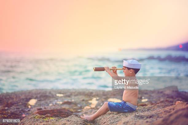 looking for pirates - young boy - sailor hat stock pictures, royalty-free photos & images