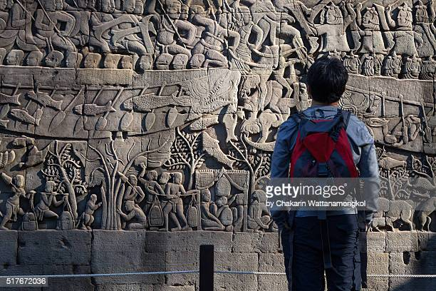 looking for the details (bayon - angkor thom) - ancient civilization stock photos and pictures