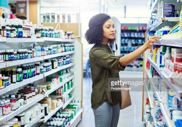 looking for the perfect remedy - pharmacy stock pictures, royalty-free photos & images