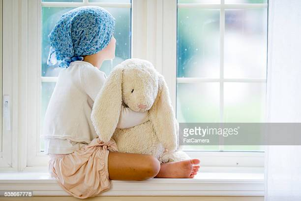 looking hopefully out the window - cancer illness stock pictures, royalty-free photos & images