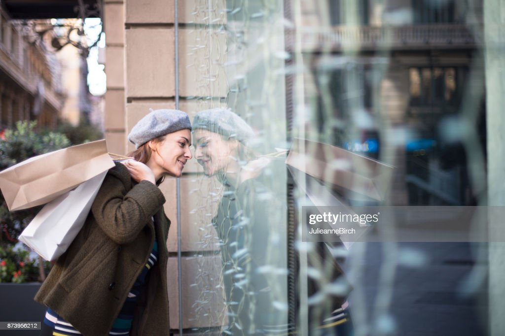 Looking in the shop window : Stock Photo
