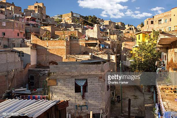 looking into mexican favela housing on hillside - mexican god stock pictures, royalty-free photos & images