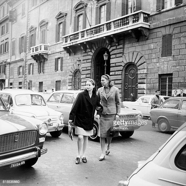 Looking just like a mother, Ingrid Bergman clutches her daughter, Isabella's hand as she convoys the 13-year old past some sailors during a stroll in...