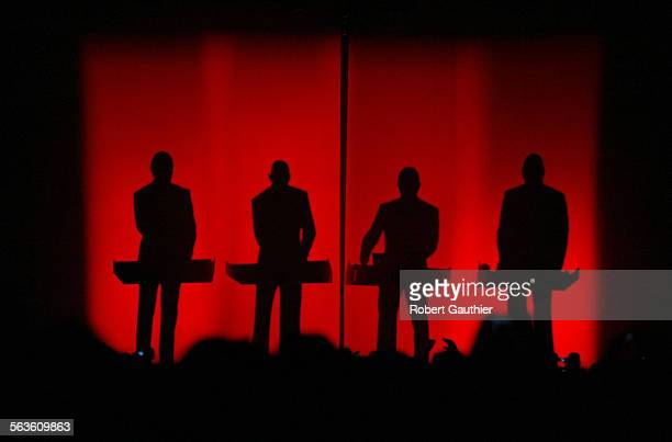 Looking larger than life, a silhouette of Kraftwerk is projected on a screen as they perform on day one of the two–day Coachella Music and Arts...