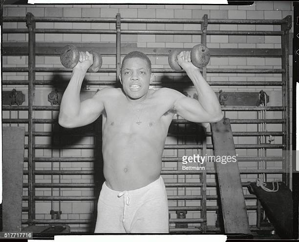 Looking more like a pugilist than the baseball great he is, Willie Mays of San Francisco Giants gets in a strenuous workout here at the Harlem YMCA....