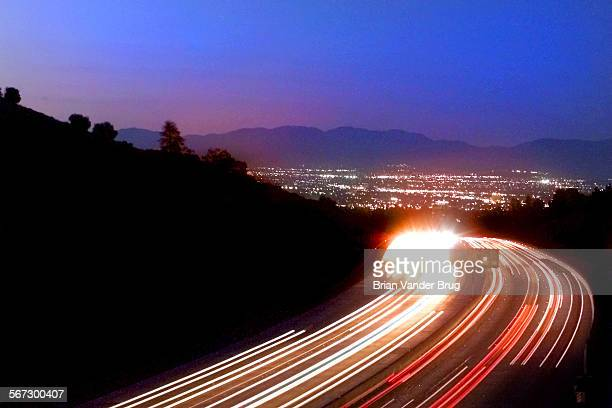 Looking northbound along the 405 freeway in the Sepulveda Pass a view of the lights of the San Fernando Valley opens up from the bridge at Mulholland...