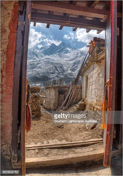 Looking out a temple doorway in Karkhot Jompa to the mountains, Mustang, Nepal.