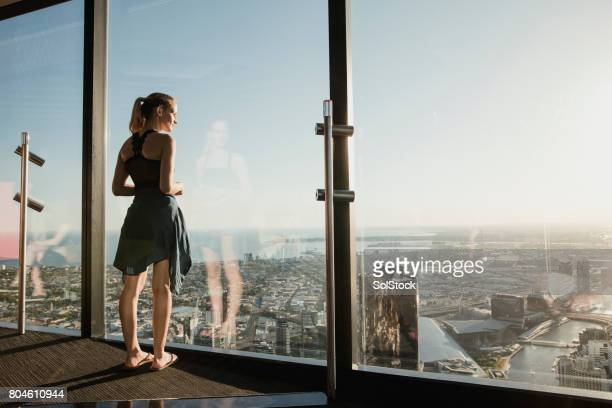 looking out across melbourne - tall blonde women stock photos and pictures