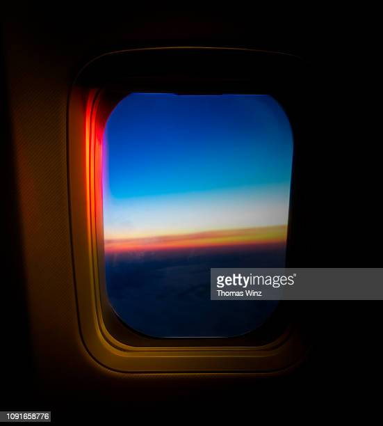 looking out airplane window at sunrise - aerospace stock pictures, royalty-free photos & images
