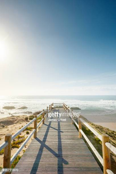 looking out at boardwalk overlooking a beach on sunny day, portugal - algarve fotografías e imágenes de stock