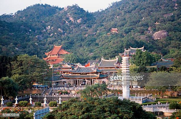 Looking out at the Nanputuo Temple in Xiamen. The Nanputuo Temple is located on the southeast of Xiamen Island. It is surrounded by the graceful sea...