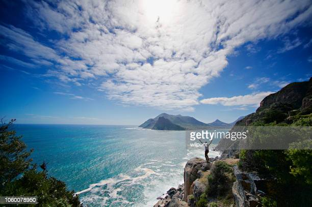looking out from chapman's peak arms raised - south africa stock pictures, royalty-free photos & images
