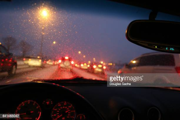 looking out of a moving car on a rainy night - dashboard camera point of view stock photos and pictures