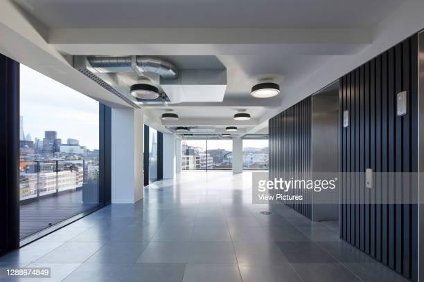 Looking out of the upper floor windows. 75 Farringdon Road, London, United Kingdom. Architect: Buckley Grey Yoeman, 2019.