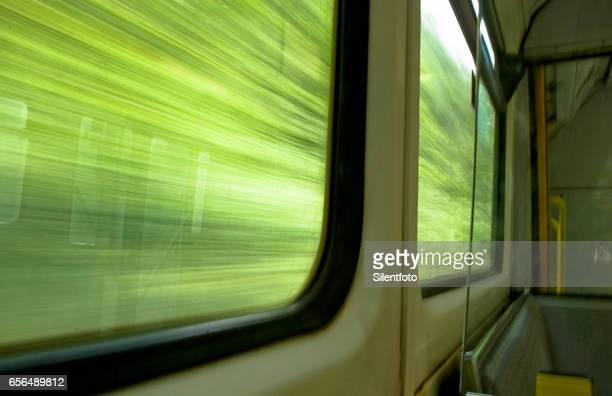 looking out of train window at foliage whizzing passed - moving past stock pictures, royalty-free photos & images