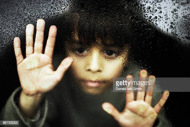 looking out of  window - pakistani boys stock photos and pictures