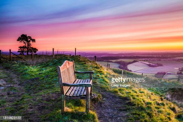 Looking out over the Vale of Pewsey in Wiltshire at sunrise.