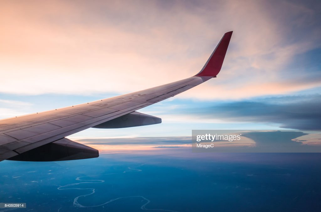 Looking Out the Window of a Plane, Cloudscape : Stock Photo