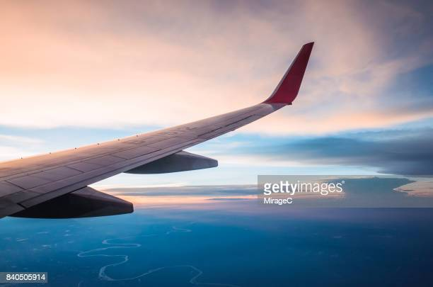 looking out the window of a plane, cloudscape - aeroplane stock photos and pictures
