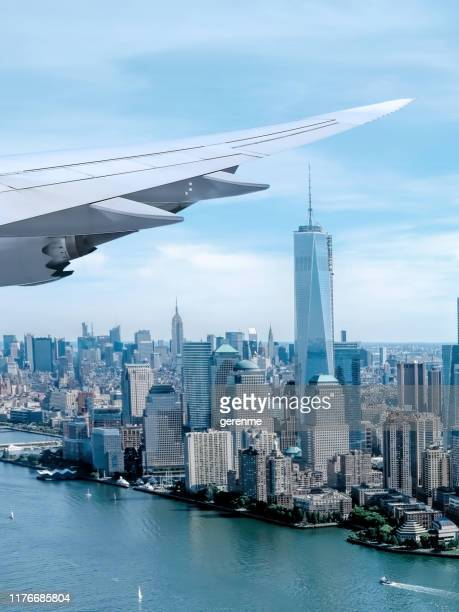 looking out to new york from a plane window - usa stock pictures, royalty-free photos & images