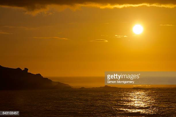 looking out to sea from st. ives at sunset - st ives stock pictures, royalty-free photos & images