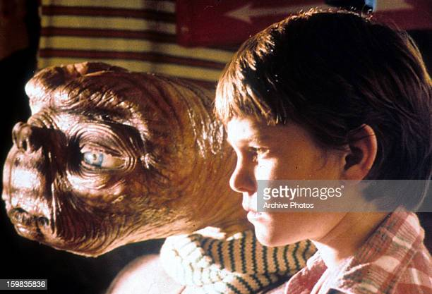 ET looking out window with Henry Thomas in a scene from the film 'ET The ExtraTerrestrial' 1982