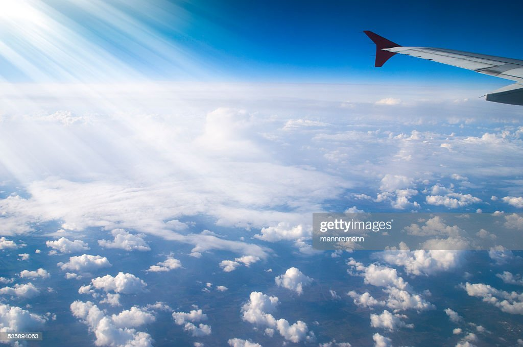 Looking over aircracft wing : Stock Photo