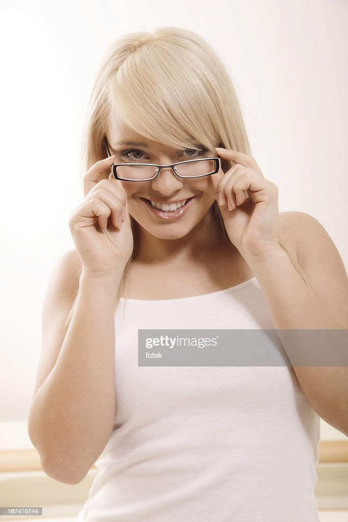 Looking over eyeglasses : Stockfoto
