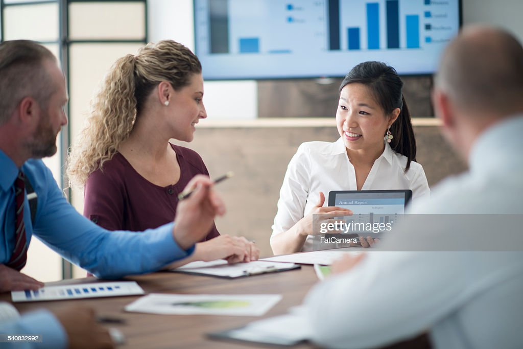 Looking Over Facts and Figures : Stock Photo