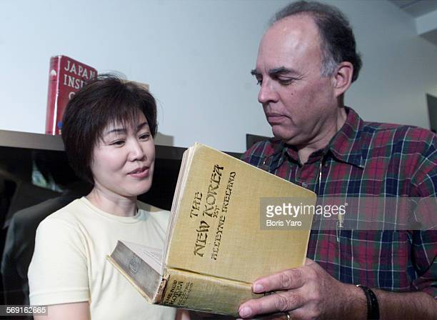 Looking over one of the books from a collection of Korean History at CSUN's Oviatt Library are Jina Choi Wakimoto, catalog librarian and Tony Gardner...