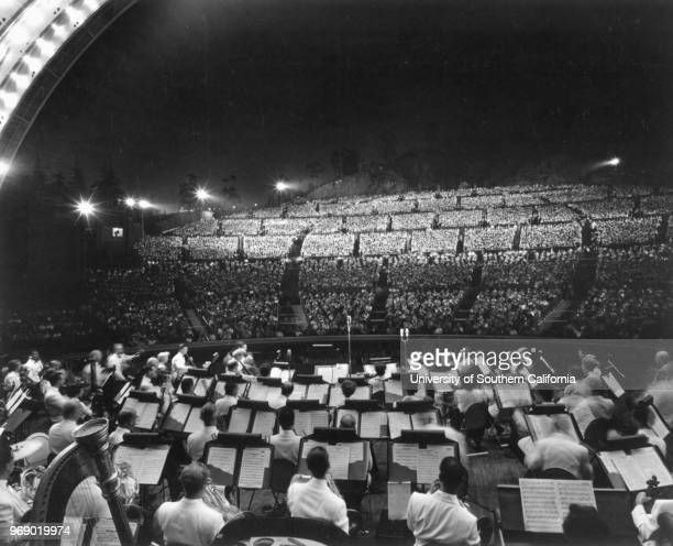 Looking over the orchestra toward the audience during a Symphony Under the Stars at the Hollywood Bowl Los Angeles California early to mid twentieth...
