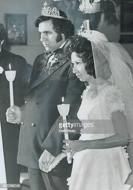Looking solemn during their Greek Orthodox wedding Saturday are NinaMaria Cira and Theodore Habib Later a candlelight reception was held in the Royal...