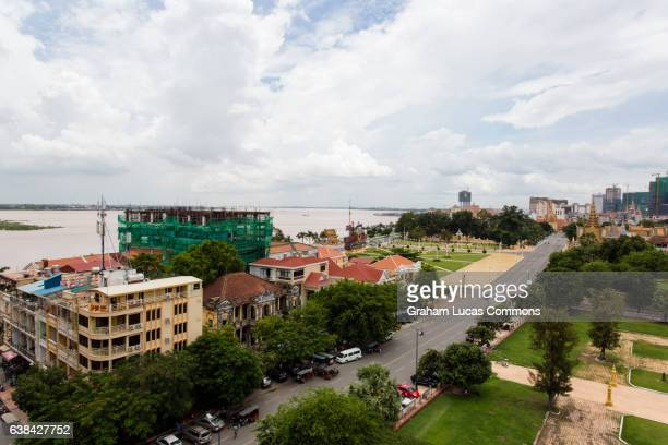 looking south-east over phnom penh skyline towards the tonle sap and mekong river and wat botum park opposite the royal palace. - wat stock pictures, royalty-free photos & images