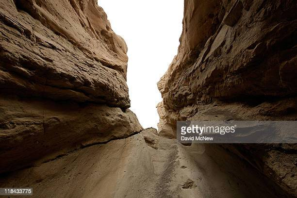 Looking straight up from inside a slot canyon, layers of earth that are pushed into vertical positions by the collision of the Pacific and North...