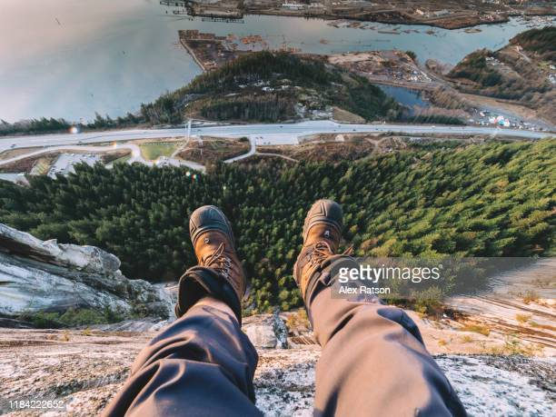 looking strait down the shear cliffs of the stawamus chief - high up stock pictures, royalty-free photos & images