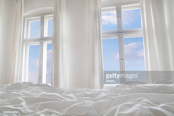 Looking the blue sky through bedroom windows