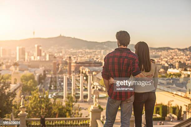 looking the sun going down in barcelona - barcelona spain stock photos and pictures