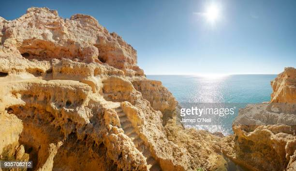 looking through a cave out to sea, algar seco, algarve, portugal - algarve stock photos and pictures
