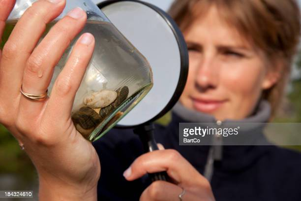 Looking through a magniying glass.