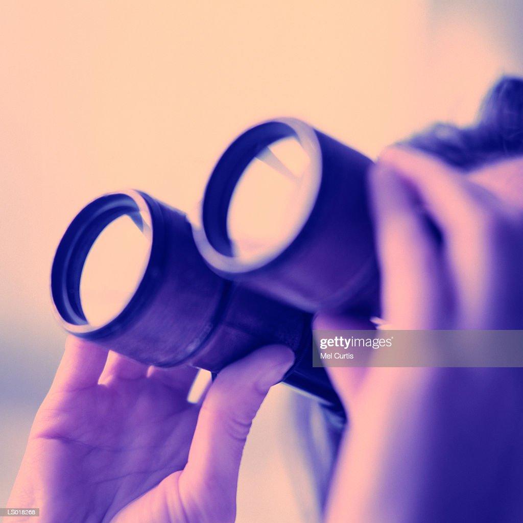 Looking through Binoculars : Stock Photo