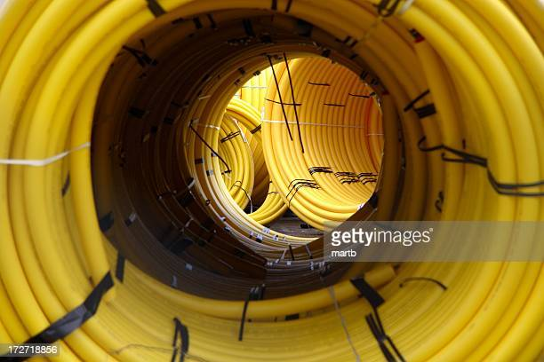 Looking through coils of yellow plastic pipe