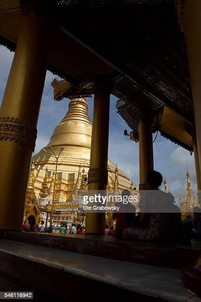 Looking through columns to the Shwedagon Pagoda in Yangon on June 16 2016 in Yangon Myanmar