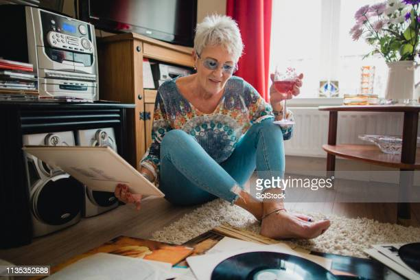 looking through her vinyl record collection - showus stock pictures, royalty-free photos & images