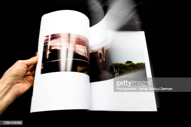 looking through magazine, turning pages - magazine page stock photos and pictures