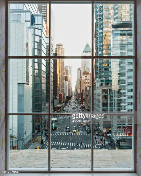 looking through paned glass window southward down 8th avenue in new york, ny. - look down stock-fotos und bilder