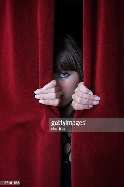 Looking through red curtains